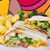 Crispy Chicken , Streaky Bacon , chilli jam & cheese toasted wrap with chips