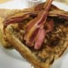 Cinnamon French Toast topped with Crispy Streaky Bacon & maple sauce