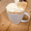 Pumpkin Spiced Latte topped with cream & toasted marshmallows